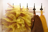 Knitted baby clothes ant tulle in fall colors - 175340424