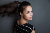 young pretty woman portrait with ponytail studio shot - 175340619
