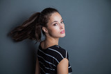 young pretty woman portrait with ponytail studio shot - 175340644