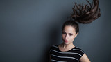 young pretty woman portrait with ponytail studio shot - 175340677