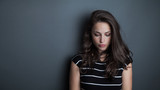 young beautiful pensive woman portrait studio - 175340678