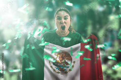 Mexican female fan holding the national flag