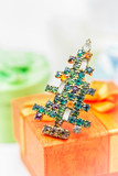 Merry Christmas and Happy New Year. Vintage brooch Christmas tree and a gift box