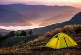 Yellow tent on a hill in the morning. - 175346822