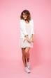 Full length portrait of a girl in summer dress posing