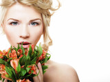 Beautiful blond girl with flowers on a white background. - 175357883