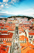 Saint George's Castle and Lisbon old town from Santa Justa mirador, Portugal, retro toned