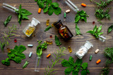 Herbal medicine pattern. Leaves, bottles and pills on wooden background top view - 175366454