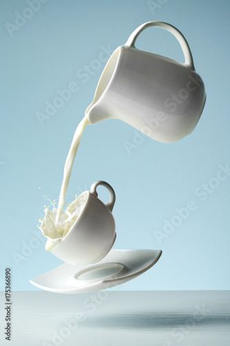 Foto op Aluminium Milkshake Flying cup with milk