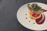 Restaurant meals. Duck confit with vegetables on black backgroun - 175368602