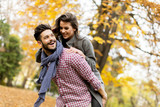 Lovely young couple in the autumn forest - 175371610