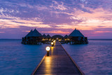 Angaga Resort. On the Sunset. Luxury rich colors of sunset over the Resort in the Maldives Islands. - 175374001