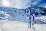 Ski in winter season, mountains and ski touring backcountry equipments on the top of snowy mountains in sunny day. South Tirol, Solda in Italy. - 175374491
