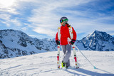 Girl on skiing on snow on a sunny day in the mountains. Ski in winter seasonon, the tops of snowy mountains in sunny day. South Tirol, Solda in Italy. - 175375006