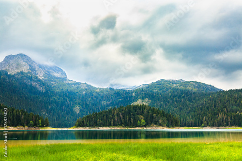 Foto op Canvas Bergen High Mountain and Black Lake at cloudy daytime, Durmitor National Park, Zabljak, Montenegro.
