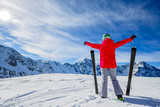 Girl on skiing on snow on a sunny day in the mountains. Ski in winter seasonon, the tops of snowy mountains in sunny day. South Tirol, Solda in Italy. - 175375247