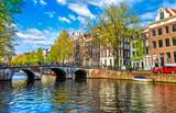 Bridge over channel in Amsterdam Netherlands houses river Amstel - 175375249