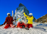 Happy family enjoying winter vacations in mountains . Ski, Sun, Snow and fun. - 175377434