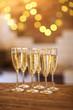 Quadro Champagne glasses on golden background