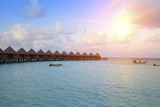 houses over the transparent quiet sea water  on a sunset. Maldives.. - 175393606