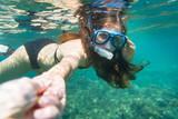 Snorkelling woman in yellow bikini makes tempting gesture in ocean - 175394850