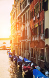 Historical streets in water canal filled with green water, Venice, Italy - 175396098