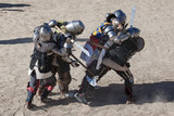 Men in a medieval battle. They are protected by armors from the 14th and 15th centuries                                                                              Medieval Wrestling Combat - 175399426