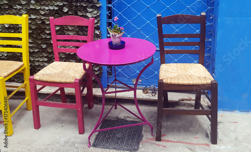 Colorful table and chairs on the street