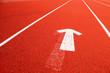 Closeup of the running tartan track with arrow symbol.