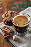 Chocolate cookies and a glass of espresso - 175411250