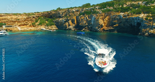 Foto op Canvas Nachtblauw Aerial view of beatiful sea with yacht and beautiful couple