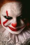 angry evil clown face looking at camera close up - 175412070