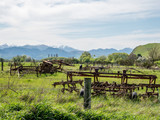 Farm machinery  in New Zealand with snow clad mountains - 175417897