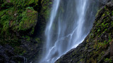 close up waterfall flowing to moisture rock cliff in deep forest thailand - 175420298