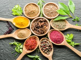 Assortment of colorful spices in the wooden spoons. - 175438877