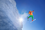 Skier jumping against blue sky from the rock - 175440034