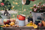 Close up view of pouring coffee in  a mug. Bright colors. Autumn decoration - 175442606