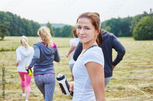 Tuinposter Jogging Junge Frau als Jogger