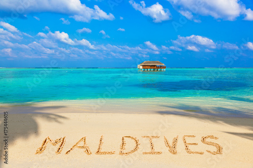 Word Maldives on beach