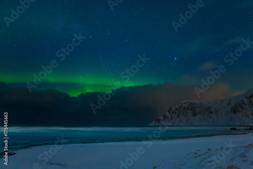 Fotobehang Noorderlicht Winter Beach and Stars and Aurora Borealis