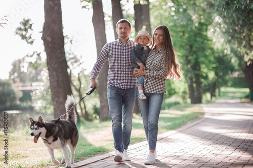 sunny pictures of a happy married couple with a dog and a child