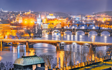 Classic panorama of Prague's bridges over Vltava river. Twilight scenery. Amazing view from above at old historical quarter. Prague, Czech Republic. Prague -famous and popular travel destination city.