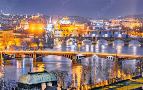 Classic panorama of Prague's bridges over Vltava river. Twilight scenery. Amazing view from above at old historical quarter. Prague, Czech Republic. Prague -famous and popular travel destination city. © Feel good studio