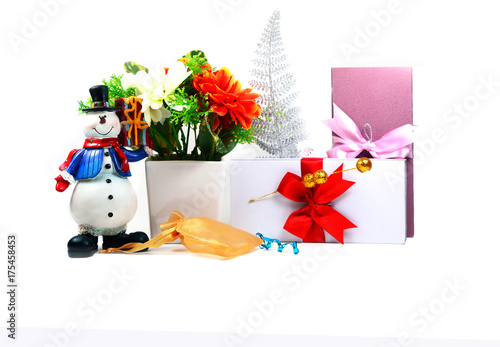 merry chrismas ,snowman doll, white vase with flowers,golden bag and gift box on Poster