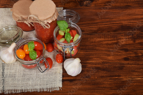 Staande foto Sap sweet fresh tomato juice with garlic with empty space for text