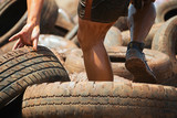 Mud race runners, tries to make it through the tire trap - 175462470
