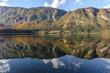 Autumn reflections on lake Bohinj, Julian Alps, the largest lake in Slovenia