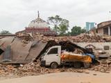 Aftermath of Nepal earthquake 2015, crushed minivan in Kathmandu - 175463859