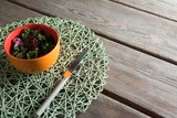 Vegetable salad in bowl with place mat at table - 175466075