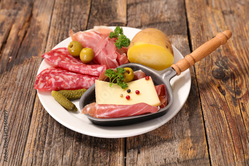 raclette cheese with salami and potato - 175466299